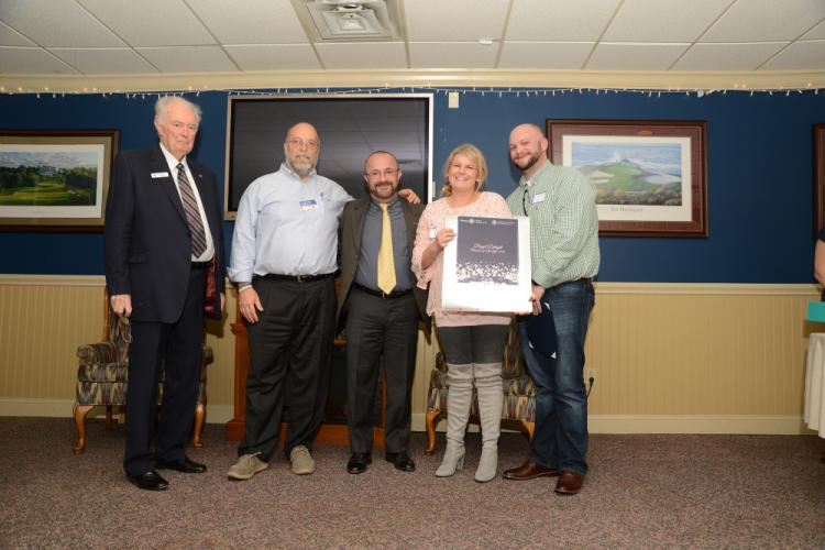 Earning the Longevity award are, at right, Kate Laverty and Brian McCluskey of Bagel Delight. Presenting the award are, from left, Chamber of Commerce President Brian Amey, Rotary President Joe Hemingway, and Alex Villamil of Prism House Painting.