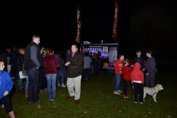 Parents, children, and pets all wait for snacks from one of several vendors Saturday night. --Bee Photo, Bobowick