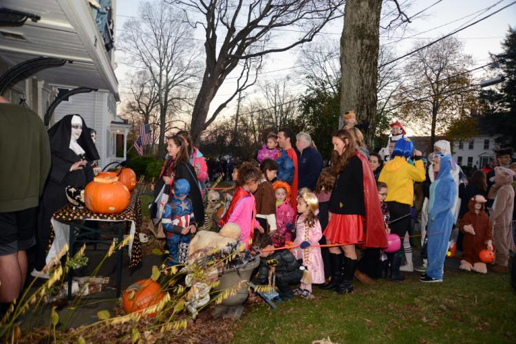 The Balcony House, 34 Main Street, was a popular stop Tuesday. As with other houses, the line of children and parents dressed for Halloween stretched along the sidewalk.	-Bee Photos, Bobowick