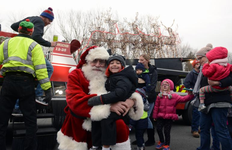 Lucky Connor Anderson got a few seconds to himself with Santa, when the jolly elf stopped in Sandy Hook to offer rides in his special sleigh.