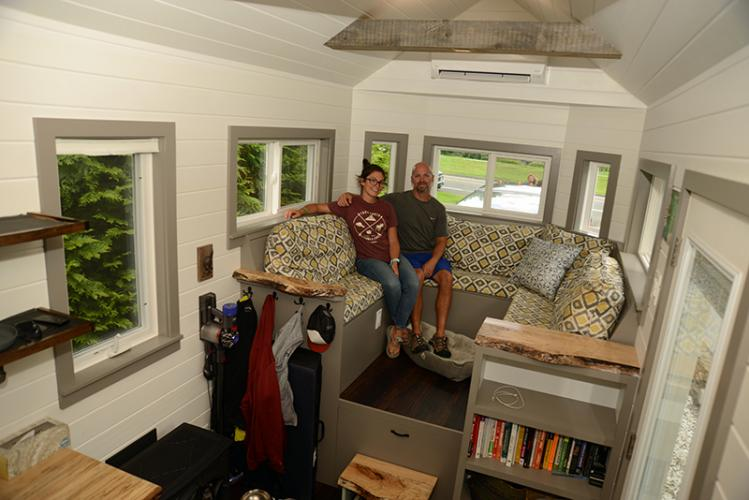 Husband and wife Erik Muzzey and Katie Pessin relax in the sitting area of their tiny house.  -Bee Photo, Bobowick