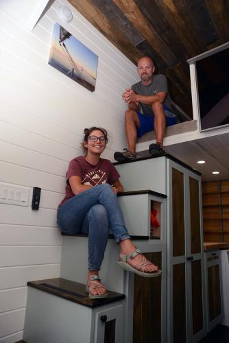 Comfortable and at home in their tiny space are Katie Pessin and husband Erik Muzzey. -Bee Photo, Bobowick