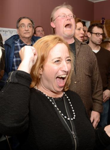 Democratic Campaign Chair Joan Plouffe and Legislative Council Vice Chairman Paul Lundquist erupt in cheers as polling numbers confirm a First Selectman race victory for Dan Rosenthal.  (Bee Photo, Bobowick)