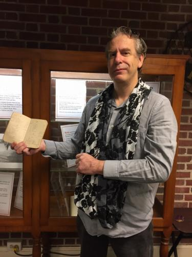 Newtown Historical Society Secretary Grant Ossendryver holds a pocket ledger that belonged to Martin Kelly, a Sandy Hook resident during the 19th Century. Mr Ossendryver has curated a display some of Mr Kelly's belongings, recently donated to the…
