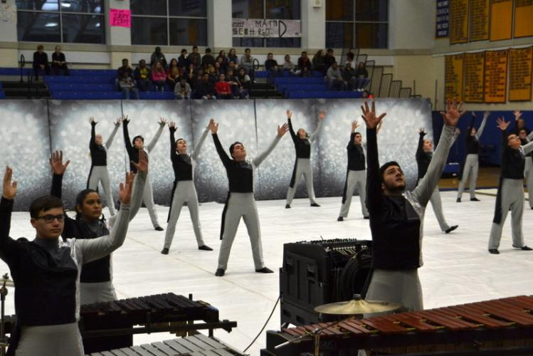 Newtown High School Winter Percussion members - in the front from left are Tristan Filiato, Nina Srivastava, David Romano - perform at the 21st Annual Winter Extravaganza at NHS on February 24. (Bee Photo Remson)