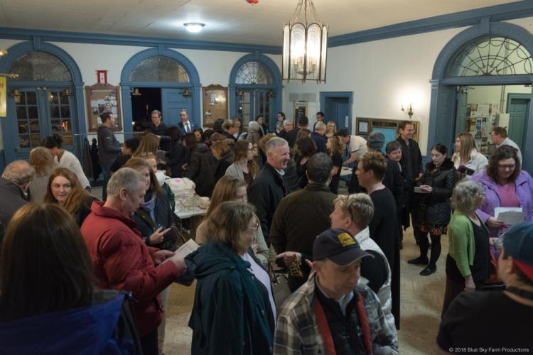 Attendees crowd into the lobby at Edmond Town Hall February 27 anticipating the second installment of the Avielle Foundation's Brainstorm Experience speaker series, which featured Golden Gate Bridge suicide survivor Kevin Hines.