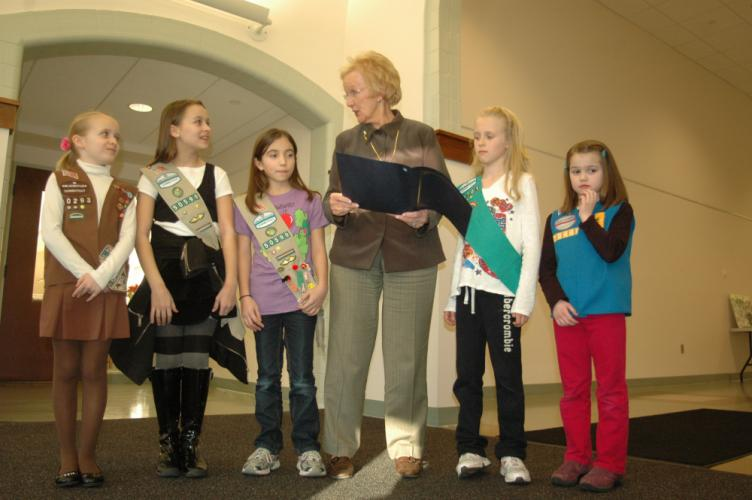 First Selectman Pat Llodra chats with a group of Girl Scouts, representing different levels of Newtown's troops, before reading a Girl Scout Month proclamation in 2012.  (Bee file photo)