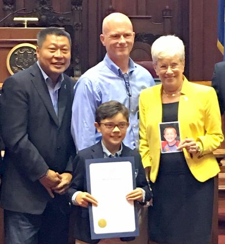 Newtown's Senator Tony Hwang, AVM sufferer young Andrew King of Middlebury, Tom Whitmore of Newtown, and Lieutenant Governor Nancy Wyman (holding a photo of Sandy Hook School student Collin Whitmore) are pictured at the State Capitol as September…