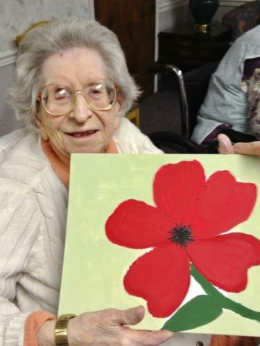 Despite losing her vision due to macular degeneration, Anna Levitt taught herself how to paint at Hancock Hall in Danbury. On August 14, 2012, at 99 years old, she masterfully painted a red flower. (photo courtesy of Lia Levitt)