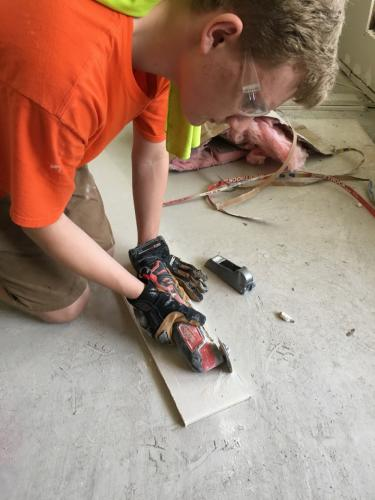 Matthew Jaeger works on drywall at a flooded home in Denham Springs, La.  (Rebecca Cosgrove photo)