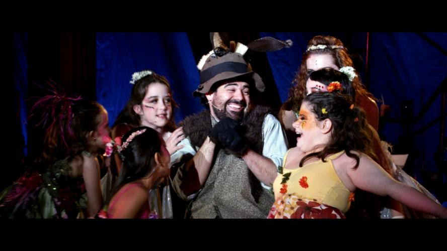 Newtown actor Sammy Sammy Vertucci is pictured just to the right of <i>A Rockin' Midsummer Night's Dream</i> principal Saum Eskandani (center) in a clip from the new documentary <i>Midsummer in Newtown</i>, which will have its world premiere April…