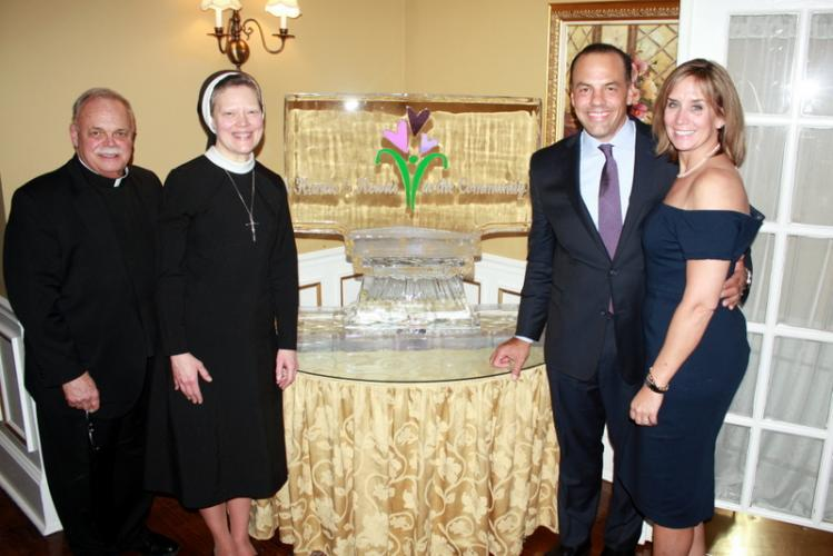 Standing together at the March 4 Hands & Hearts in the Community Service Award/Tuition Assistance Benefit Dinner from left are Monsignor Robert Weiss, Sister Colleen Therese Smith, Todd and Tami Ingersoll. (Laura Moulder photo)