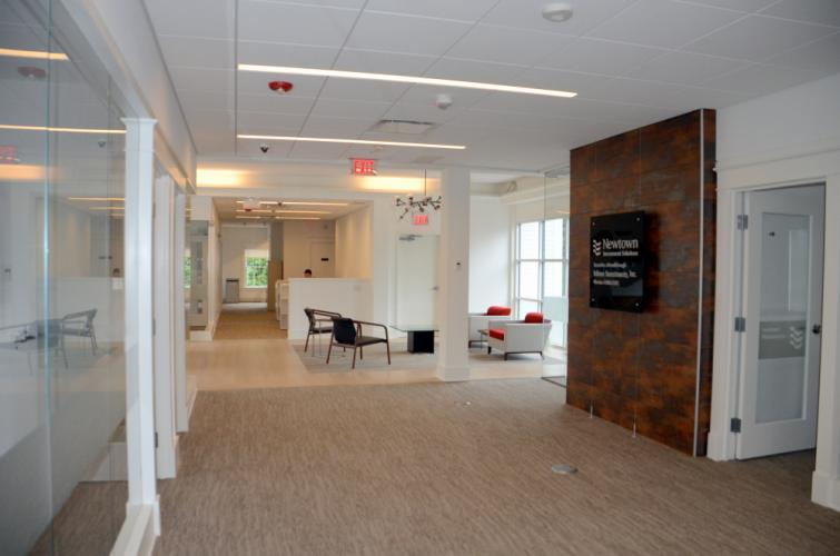 Customers can access the bank's mortgage and financial planning experts on the second floor or their safety deposit boxes in the basement via elevator or stairs that provide secure passage to all three levels of the building - even if they are…
