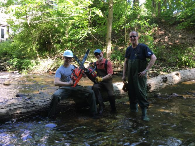Kevin Mohler, Gary Fillion, and Doug Body (as well as Bruce Bomely) came to the rescue, cutting away a tree blocking the route of the rubber ducks heading downriver for the Great Pootatuck Duck Race.