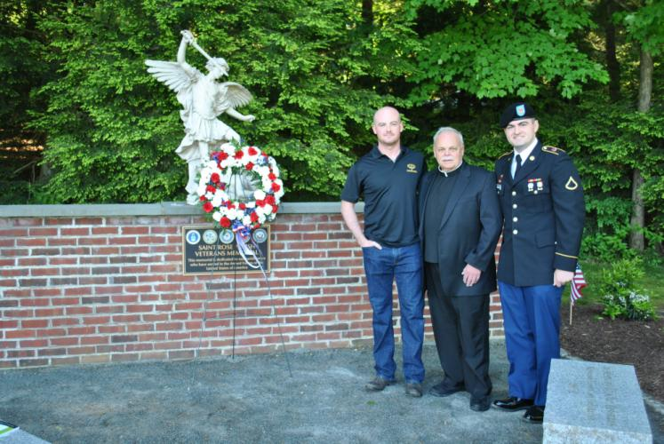 From left, 1st Lt Liam Thies, US Army aviation; Msgr Robert Weiss; and US Army Pfc Matt Rahtelli pose at the St Rose Veteran Memorial in St Rose Cemetery following a Memorial Day service there. -Bee Photo, Crevier