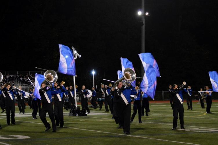 The NHS Marching Band & Guard trumpet section marches in precision at Norwalk High School on October 14. (Denise Romano photo)