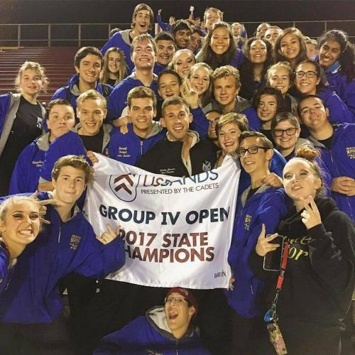 NHS Marching Band & Guard members celebrate the State Champion award on October 28 with Visual Caption Head Ricky Grasso, center. (Renee Wilson photo)