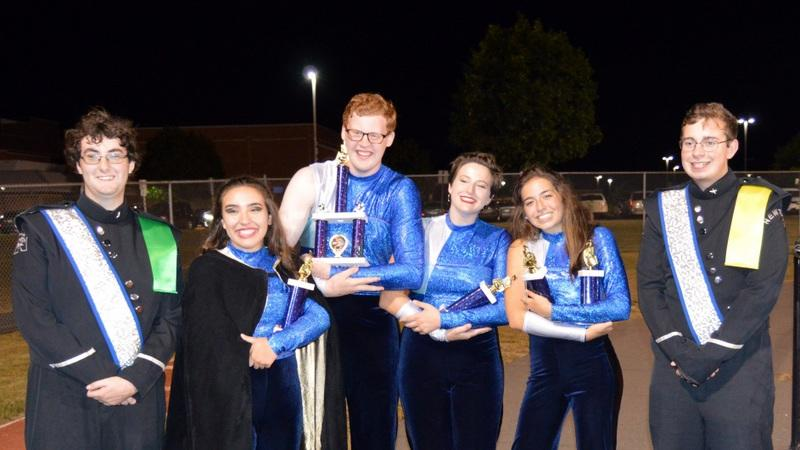 NHS Band & Guard officers, from left, Ian Klepacki, woodwind captain; Isabelle Fitzgerald, Color Guard captain; Adam Wolff, drum major; Jenna Ehnot, drum major; Grace Sholtes, drum major; and Thomas Jensen, brass captain, accept awards at the…