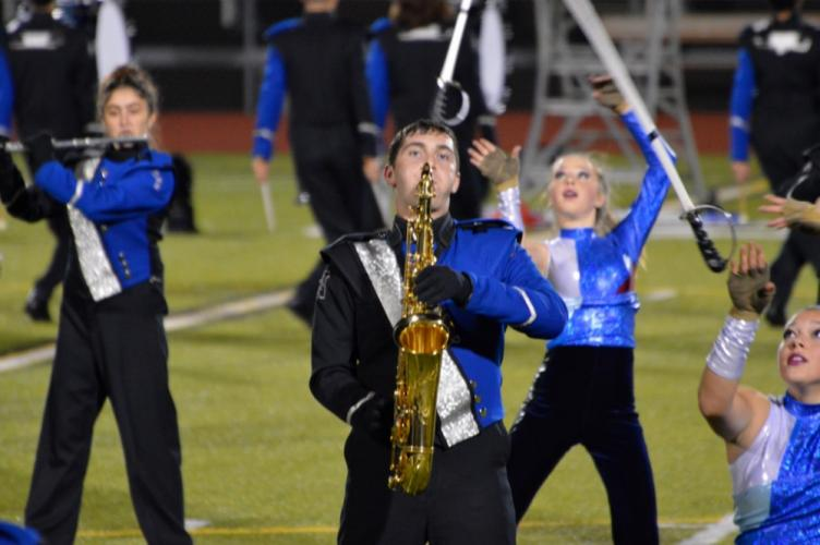NHS Marching Band member Andrew Buzzi plays tenor saxophone at Trumbull High School on November 4. (Denise Romano photo)