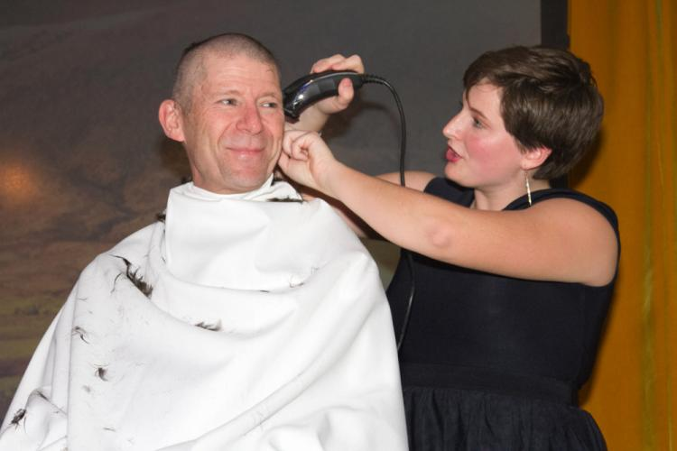 Band director Kurt Eckhardt gets his head shaved by drum major Jenna Ehnot at the end of season banquet Monday, November 13, held at the Portuguese Cultural Center in Danbury. (Benay Yaffe photo)