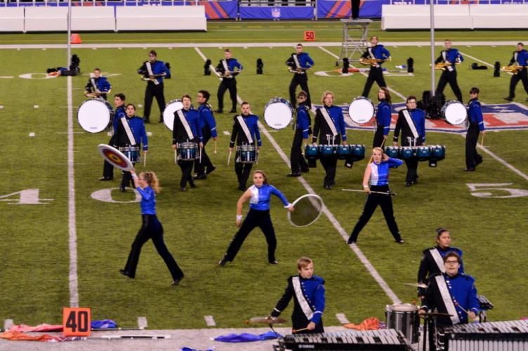 The NHS Marching Band & Guard drumline performs at Nationals. (Denise Romano photo)