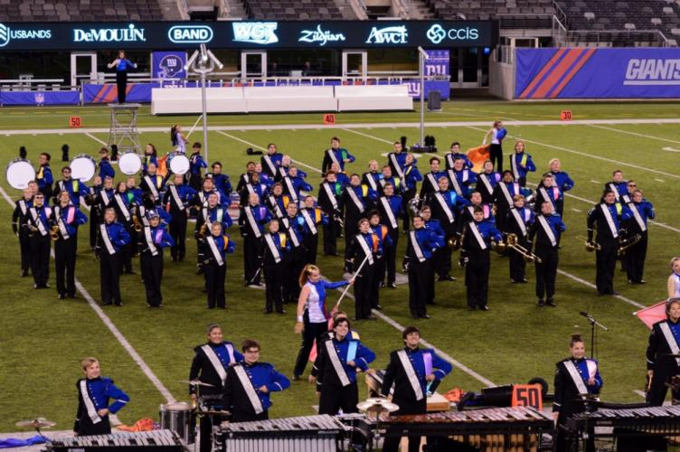 The NHS Marching Band & Guard stands in MetLife Stadium at Nationals.  (Denise Romano photo)