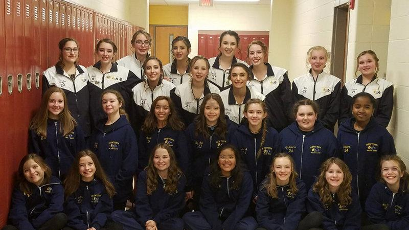 NHS Winter Guard members pose together. The NHS Varsity guard came in second at a Musical Arts Conference on March 3 at Naugatuck High School and the Junior Varsity came in first. (Kelly Hochstetler photo)