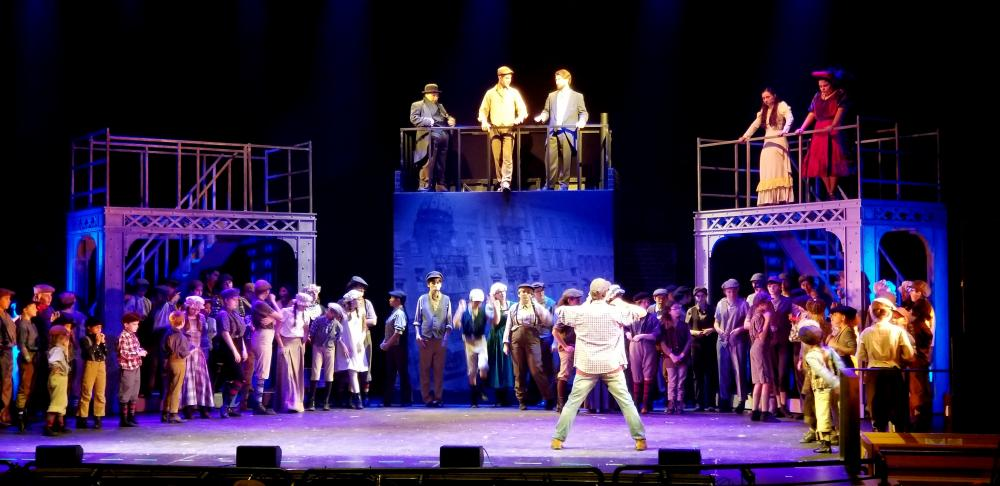 NewArts Producing Artistic Director Michael Unger stands downstage left addressing the cast of Newsies during an August 1 rehearsal at Masuk High School. The production, which is double cast, closes this weekend in the Monroe high school's auditorium.