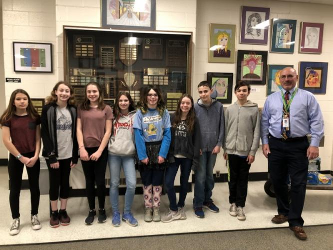 Newtown Middle School PTA Reflections program school and state winners pictured standing with Principal Thomas Einhorn, right, are, from left, Beverly Amblo, Daniella Guerrieri, Kayla Wadell, Ashley Hubner, Gillian Torreso, Alison Powers, Jackson…