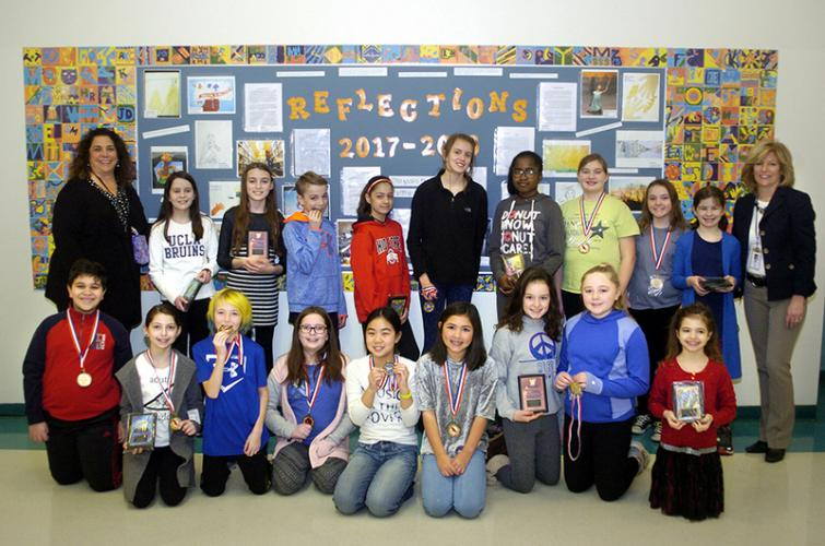 Pictured with Reed Assistant Principal Jill Beaudry, left, and Principal Anne Uberti, right, are the school's 2017-2018 Reflections and state level contest winners. Students, from left, front row, are Jonathan Ramzy, Jillian Hoag, Luke Doherty, Izzy…