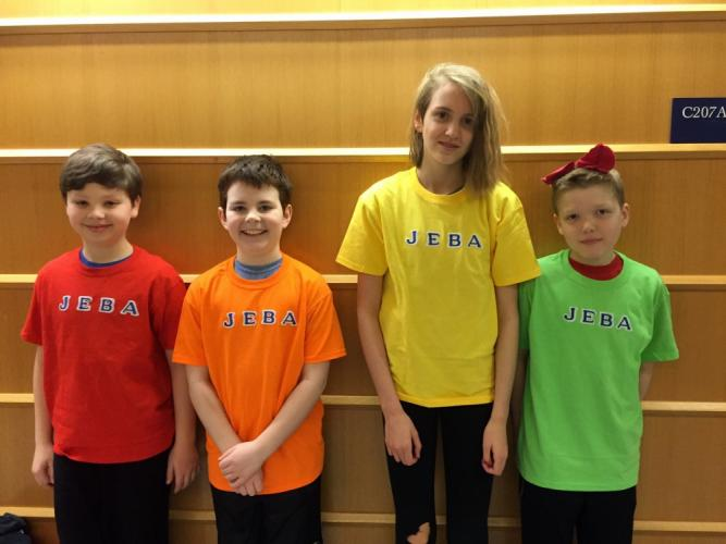 Team members on Odyssey of the Mind coach Dione Sordi's team stand together in their team T-shirts for the state tournament. From left are Ben Almstead, Aidan Sordi, Ellia Mason, and Julian Kessler.