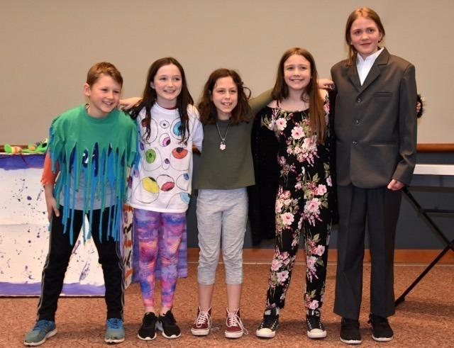 Team members on coach Heather Chappa's team stand together. From left are Noel McLeod, Ella Macey, Emma Chappa, Meghan Bailey, and Riana Mason.
