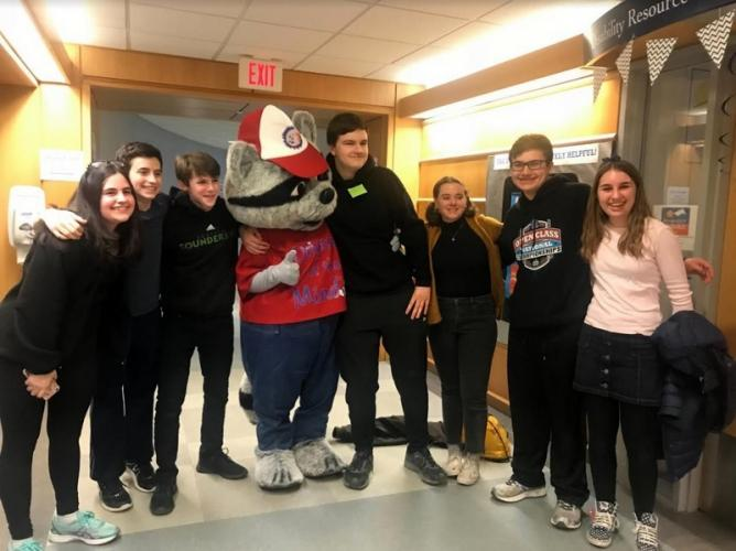 Standing at the state Odyssey of the Mind competition with the program's mascot are members of coach Carol Shuman's team, from left, Julia Shuman, Jacob Shuman, Nick Preszler, Teddy Wojcik, Rachel Tramposch, Tristan Filiato, and Hailey Pankow.