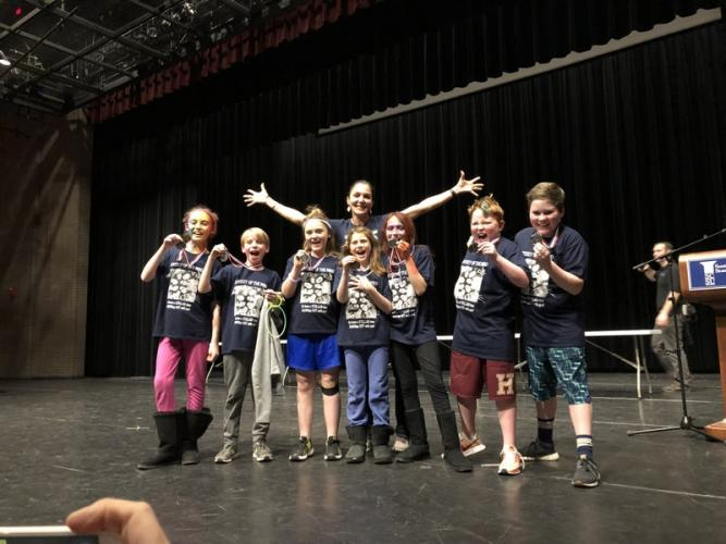 Reed Intermediate School Odyssey of the Mind team members stand with their coach Debra Sullivan, in the back, at the state competition. From left are students Sadie Baimel, Bennett Quinn, Jessica Powers, Lily Ammerman, Kaila Sullivan, Marty Dunn,…