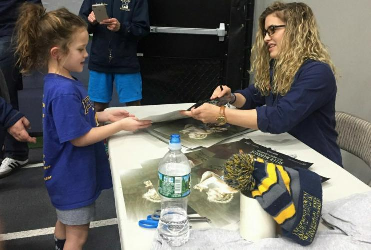 Riley Lovett gets to meet her idol, Olympic gold medalist Helen Maroulis while getting her autograph. (Jennifer Belcolore photo)
