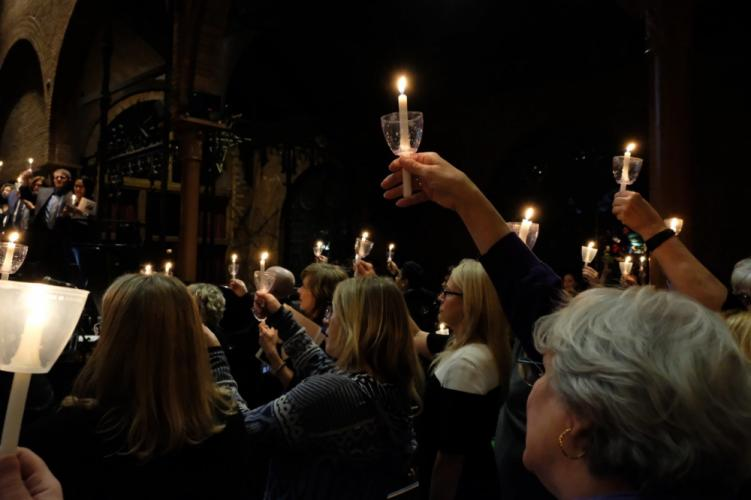 Candles representing lives lost to gun violence are held aloft in a packed St Mark's Episcopal Church in Washington, DC, as dozens of Newtown residents and hundreds of others from across the nation came together for the 5th Annual National Vigil for…
