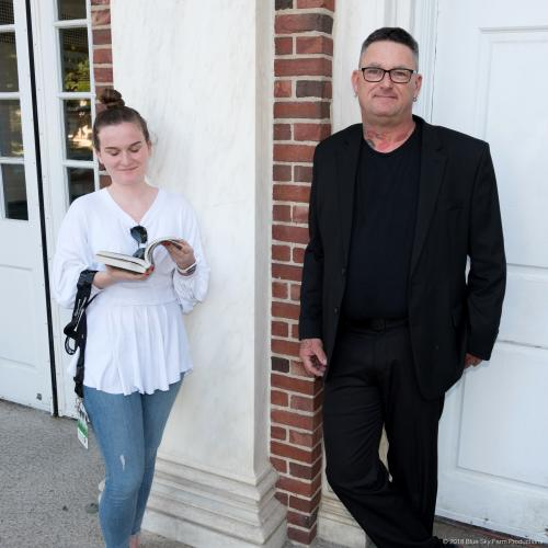 All suited up for the show, Avielle Foundation Production Manager Dave Brooker grabs a few moments of fresh air while chatting with BrainStorm Experience guest Julie LePerch in front of Edmond Town Hall, June 19.  (Phil Keane photo)
