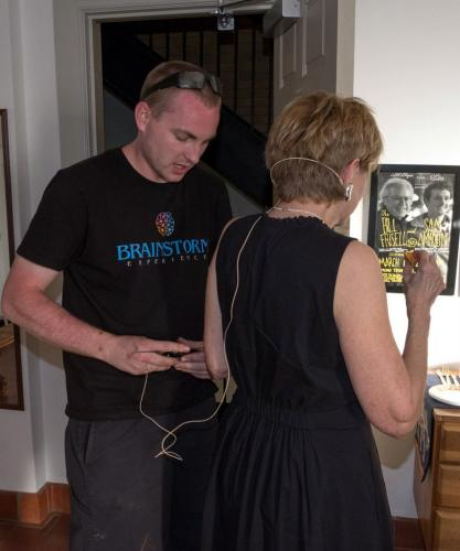 BrainStorm Experience Technical Director Alex Dunn fits special guest Jane Pauley with a headset microphone backstage before her June 19 appearance for the Avielle Foundation at Edmond Town Hall.  (Phil Keane Photo)