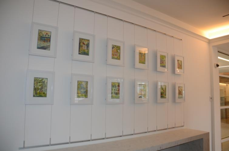 """The new branch features an original display by Newtown artist Charles Fulkerson. Titled """"Painted Ladies,"""" it features 12 historic homes along Main Street."""
