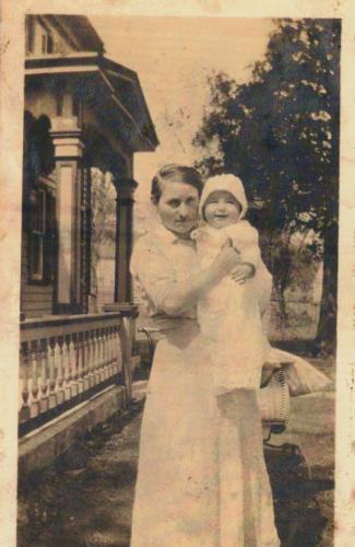 In the spring of 1917, Justyna Paproski held her young son Sam in front of the house on West Street that she worked in as a housekeeper. In 1927, Justyna and her husband Stephan would go on to established Castle Hill Farm in Newtown. (photo courtesy…