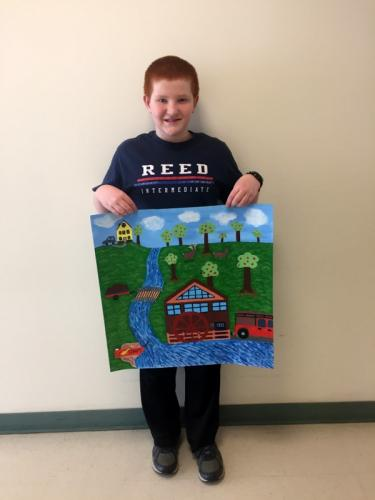 Reed Intermediate School student Connor Sinapi holds his work of art chosen as part of the Impressions of Nature art exhibit.