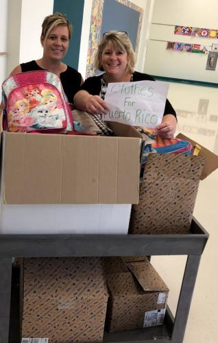 Reed PTA members Jennifer Chaudhary, left, and Debbie DeBlasi gathered clothing donations from the school to be sent to a school in Puerto Rico. Along with clothes were other items, like backpacks.