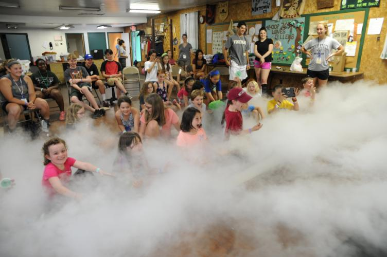 On any given day of the Resiliency Center of Newtown's summer Camp Creativity, kids never know what to expect as evidenced in this image from 2015 when one afternoon, attendees experience the magic of a theatrical fog machine.  (RCN / Jennifer…