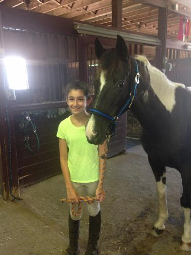 Rachel Kass, a camper at Fox Ridge Farm, stood with the pony Sioux.