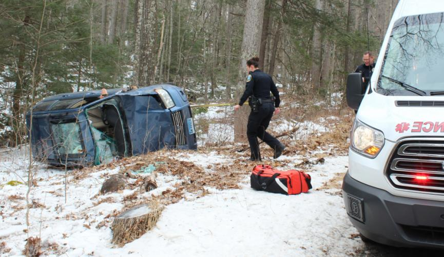 A Newtown police officer walks toward a Subaru Forester that went off Great Quarter Road and struck a tree before rolling onto its passenger side around 10:15 am, Wednesday, February 20. An unidentified male driver had reportedly been traveling west when he lost control of his vehicle just west of Andras Road. Newtown Volunteer Ambulance Corps and Sandy Hook Volunteer Fire & Rescue firefighters also responded to the accident, which closed the roadway for a short time. The driver was checked for injuries but