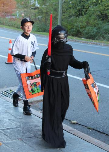An unusual pair: Retired Yankees shortstop Derek Jeter and Star Wars baddie Kylo Ren head up Church Hill Road during Halloween 2016. The Newtown Fire Marshal has issued some public safety tips as Halloween once more draws near.  (Bee file photo)