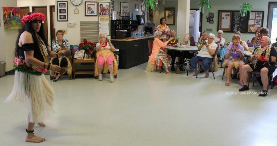 SH_Hawaiian-party-at-senior-center-04-Michaels-leading-coconut-song-WATERMARKED-e1533831015832.jpg