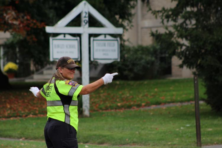 Newtown's Smiling Traffic Agent will be retiring from her post as of Friday, September 29.  (Bee Photo, Hicks)