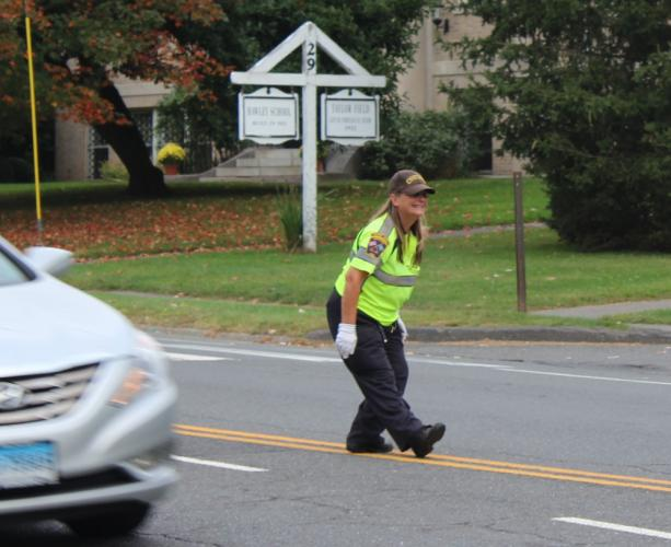 "Kat Holick tries to smile for every driver and pedestrian she sees while directing traffic safely into and out of schools. ""I am hoping that from here forward, that smile made a difference,"" said the outgoing traffic agent.  (Bee Photo, Hicks)"