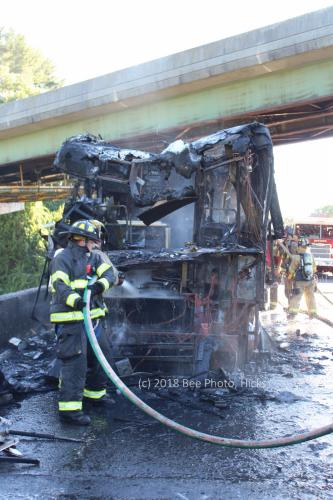 SH_I-84-camper-fire-02-Hook-Ladder-firefighters-soaking-interior.jpg